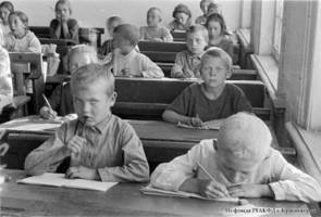 School children during classes in one of the collective farms of the Volga German Autonomous Soviet Socialist Republic, 1932.