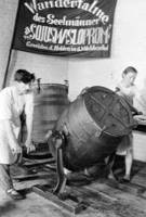 The workers of the Laub collective farm [pictured] during the butter making process at the farm's dairy, 1933.