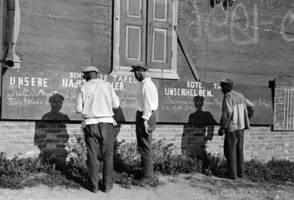 Collective farm workers at a street news board, 1933.